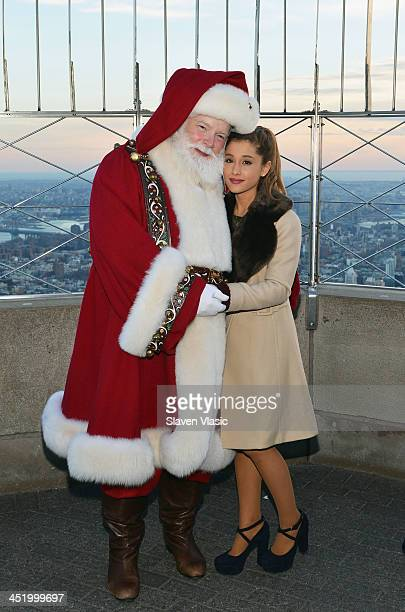 Actress/singer Ariana Grande and Santa Claus visit The Empire State Building on November 25 2013 in New York City