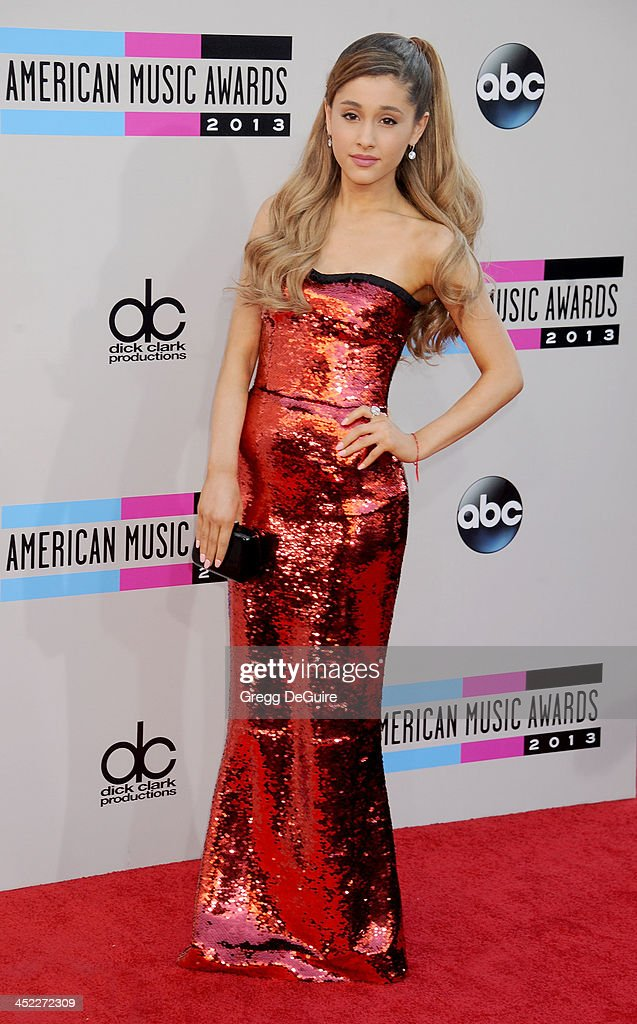 Actress/singer Ariana Grande arrives at the 2013 American Music Awards at Nokia Theatre L.A. Live on November 24, 2013 in Los Angeles, California.