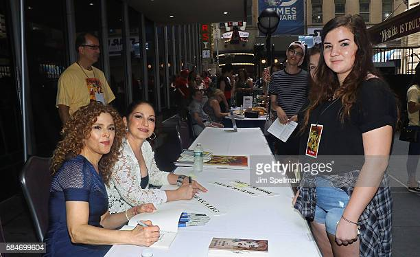 Actress/singer Bernadette Peters and singer/songwriter Gloria Estefan meet the fans at the 18th Annual Broadway Barks at Shubert Alley on July 30...