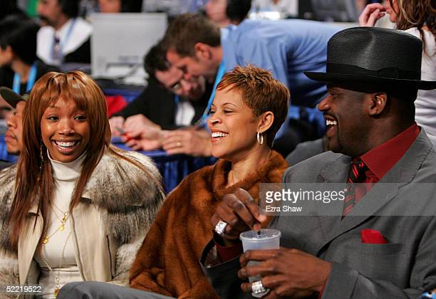 Actress/singer Brandy Shaunie O'Neal and Shaquille O'Neal of the Miami Heat sit courtside during the Foot Locker ThreePoint Shootout part of 2005 NBA...