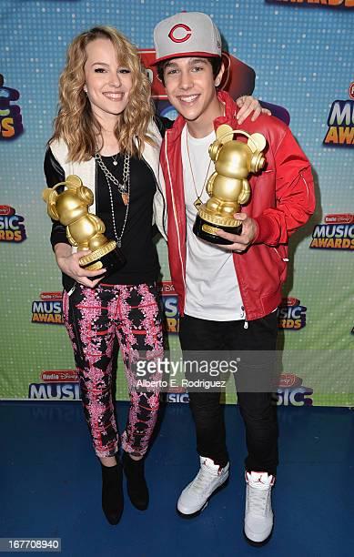 Actress/singer Bridgit Mendler and singer Austin Mahone pose backstage at the 2013 Radio Disney Music Awards at Nokia Theatre L.A. Live on April 27,...