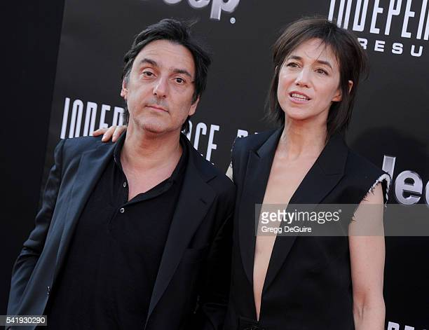 Actress/singer Charlotte Gainsbourg and actor Yvan Attal arrive at the premiere of 20th Century Fox's Independence Day Resurgence at TCL Chinese...