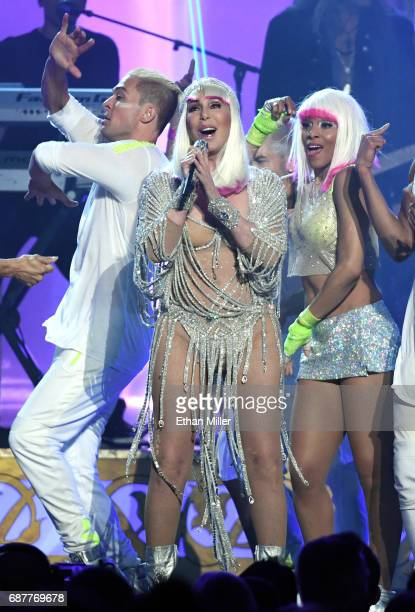 Actress/singer Cher performs with dancers during the 2017 Billboard Music Awards at TMobile Arena on May 21 2017 in Las Vegas Nevada