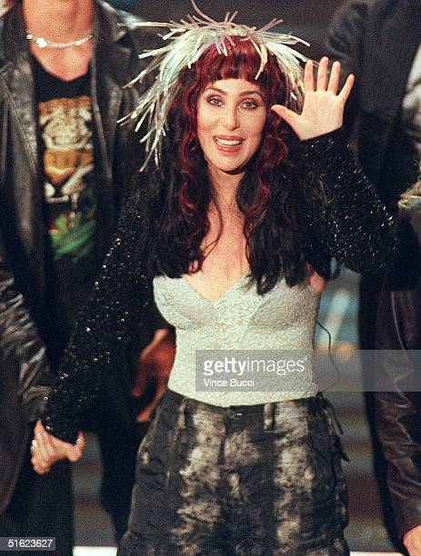 Actresssinger Cher waves to fans after performing during the 26th Annual American Music Awards 11 January in Los Angeles Ca The veteran singer is...
