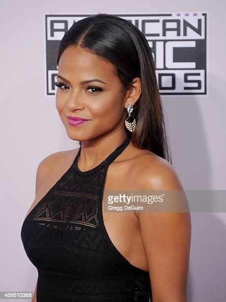 Actress/singer Christina Milian arrives at the 2014 American Music Awards at Nokia Theatre LA Live on November 23 2014 in Los Angeles California