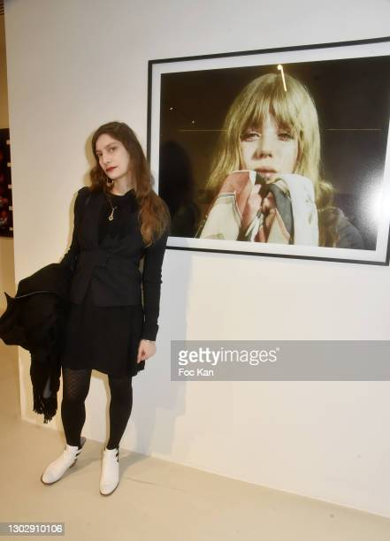 Actress/singer Delphine André poses with a portrait of Marianne Faithfull by Photographer/cineast Kenneth Anger during American Filmmakers and...