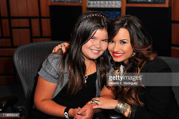 Actress/singer Demi Lovato and sister actress Madison De La Garza attend a Live Chat at Cambio Studios on July 21 2011 in Hollywood California