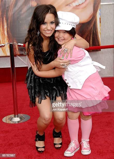 Actress/singer Demi Lovato and sister actress Madison De La Garza arrive at the Los Angeles Premiere 'Hannah Montana The Movie' at the El Capitan...
