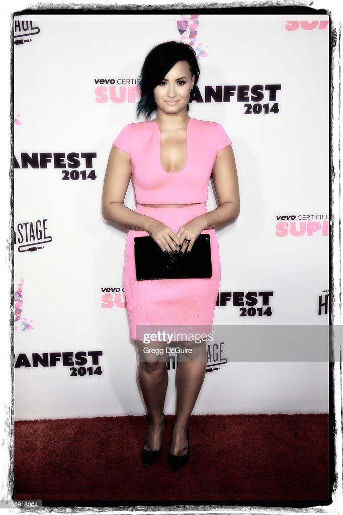 Actress/singer Demi Lovato arrives at the Vevo CERTIFIED SuperFanFest live concert event at Barker Hangar on October 8, 2014 in Santa Monica, California.