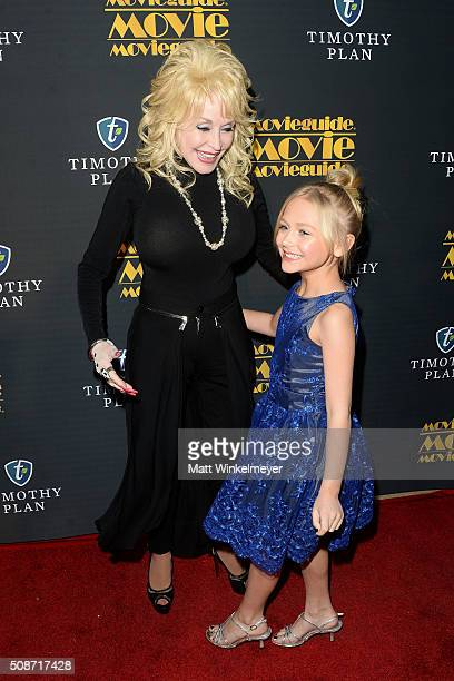Actress/singer Dolly Parton and actress Alyvia Alyn Lind arrive at the 24th annual Movieguide Awards Gala at Universal Hilton Hotel on February 5...