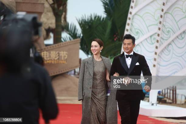 Actress/singer Fann Woon Fong and husband actor Christopher Lee arrive at the red carpet during the closing ceremony of 1st Hainan International Film...