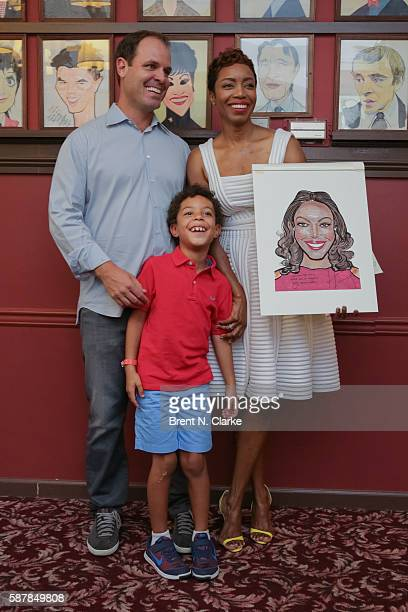 Actress/singer Heather Headley her husband Brian Musso and son John David Musso pose with her Sardi's caricature during the unveiling ceremony held...