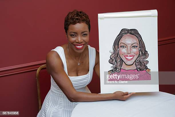 Actress/singer Heather Headley poses with her Sardi's caricature during the unveiling ceremony held at Sardi's on August 9 2016 in New York City