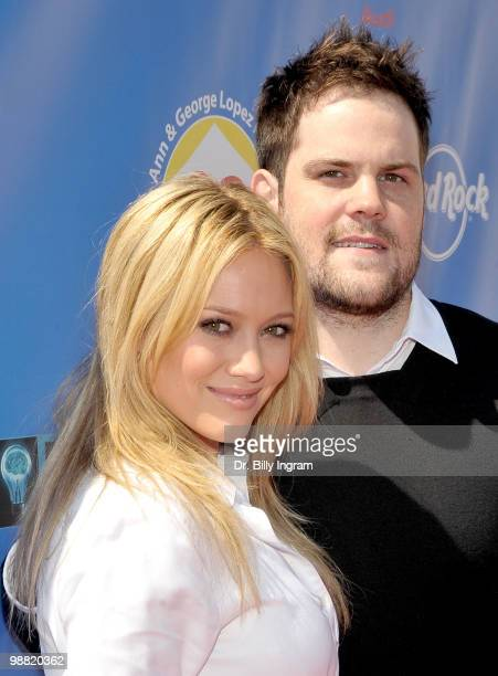 Actress/singer Hilary Duff and hockey player Mike Comrie arrive at the Third Annual George Lopez Celebrity Golf Classic at the Lakeside Golf Club on...