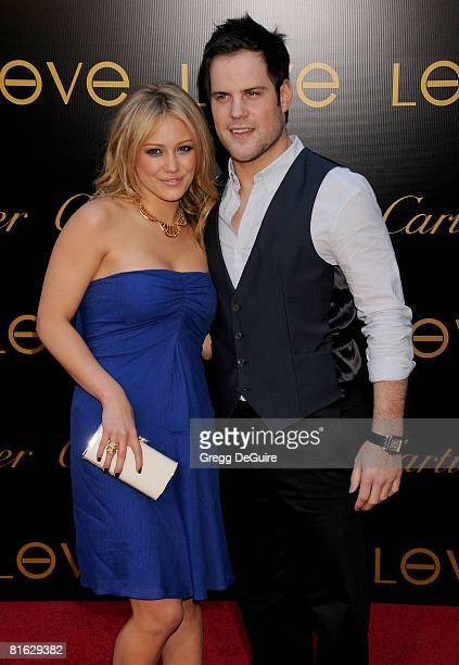 Actress/singer Hilary Duff and New York Islander hockey player Mike Comrie arrive at the Cartier Charity Love Bracelet Launch on June 18 2008 at a...