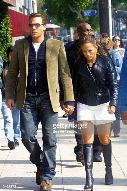 Actress/singer Jennifer Lopez and actor Ben Affleck hold hands while filming her new music video at Barefoot restaurant on October 20 2002 in Beverly...