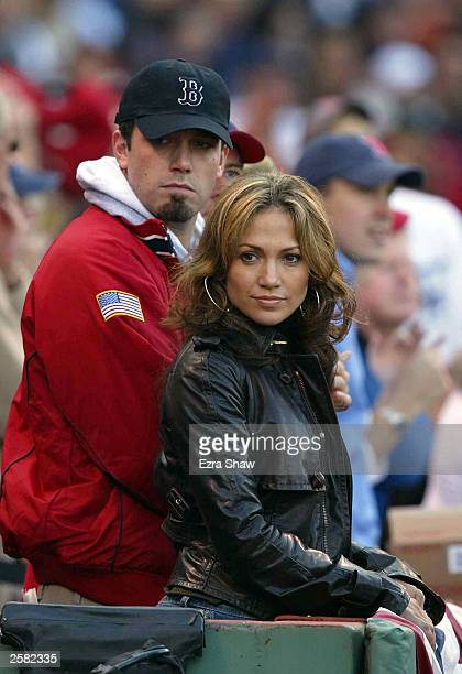 Actress/singer Jennifer Lopez and boyfriend actor Ben Affleck watch the New York Yankees take on the Boston Red Sox during Game 3 of the 2003...