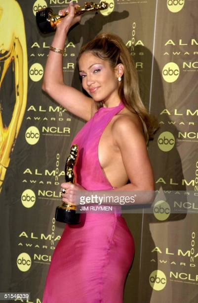 US actress/singer Jennifer Lopez poses for photographers with the two ALMA awards she won for female entertainer of the year and for outstanding...