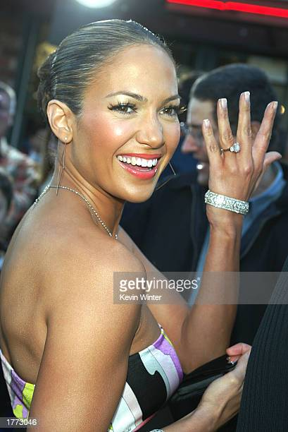 """Actress/singer Jennifer Lopez shows fans her engagement ring as she arrives at the premiere of """"Daredevil"""" at the Village Theatre on February 9, 2003..."""
