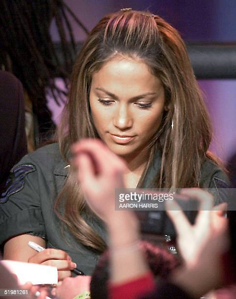 Actresssinger Jennifer Lopez signs autographs during a promotional appearance for her new album JLo 13 February 2001 in Toronto Canada Lopez...