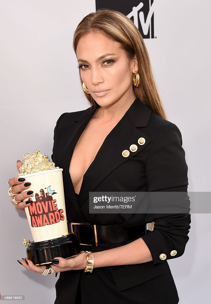 Actress/singer Jennifer Lopez, winner of Best Scared-As-S**t Performance for 'The Boy Next Door,' poses in the press room during The 2015 MTV Movie Awards at Nokia Theatre L.A. Live on April 12, 2015 in Los Angeles, California.