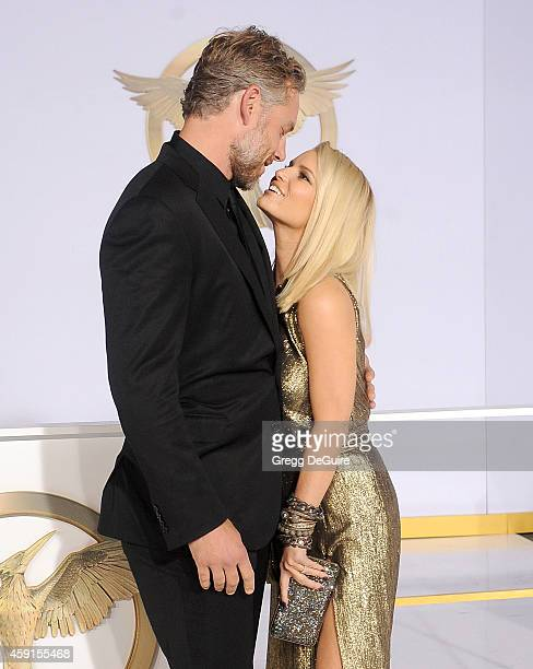 Actress/singer Jessica Simpson and husband Eric Johnson arrive at the Los Angeles premiere of The Hunger Games Mockingjay Part 1 at Nokia Theatre LA...