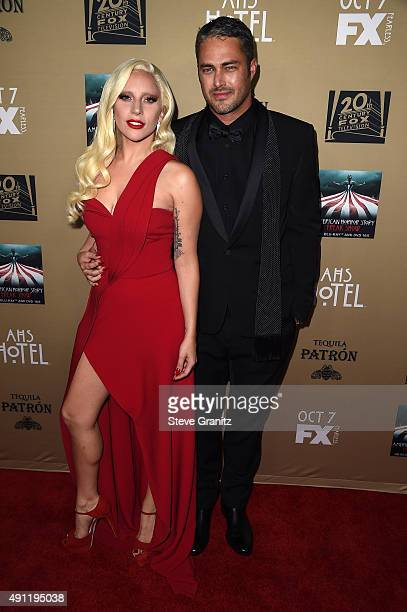 """Actress/singer Lady Gaga and actor Taylor Kinney attend the premiere screening of FX's """"American Horror Story: Hotel"""" at Regal Cinemas L.A. Live on..."""
