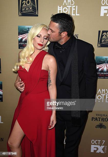 Actress/singer Lady Gaga and actor Taylor Kinney attend the premiere screening of FX's 'American Horror Story Hotel' at Regal Cinemas LA Live on...