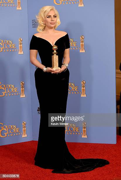 Actress/singer Lady Gaga winner of Best Performance in a Miniseries or Television Film for 'American Horror Story Hotel' poses in the press room...