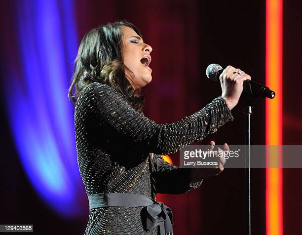 Actress/singer Lea Michele performs onstage at 2011 MusiCares Person of the Year Tribute to Barbra Streisand at Los Angeles Convention Center on...
