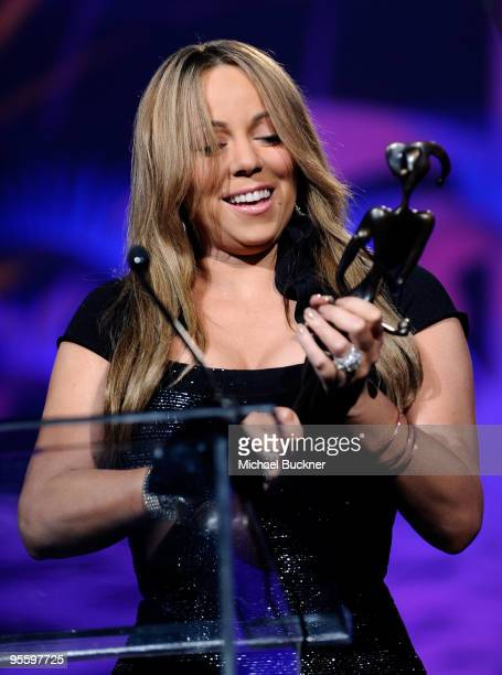 Actress/singer Mariah Carey accepts the Breakthrough Actress Performance award onstage at the 2010 Palm Springs International Film Festival gala held...