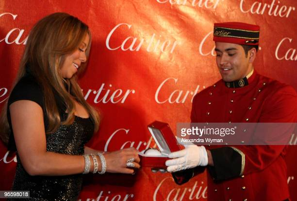 Actress/singer Mariah Carey poses backstage during the 2010 Palm Springs International Film Festival gala held at the Palm Springs Convention Center...