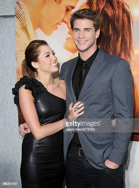 Actress/singer Miley Cyrus and actor Liam Hemsworth arrive at the premiere of Touchstone Picture's 'The Last Song' held at ArcLight Hollywood on...