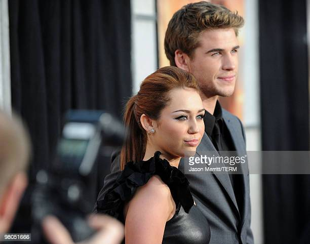Actress/singer Miley Cyrus and actor Liam Hemsworth arrive at the premiere of Touchstone Picture's The Last Song held at ArcLight Hollywood on March...