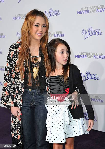 Actress/singer Miley Cyrus and actress Noah Cyrus arrive at the premiere of Paramount Pictures' Justin Bieber Never Say Never held at Nokia Theater...