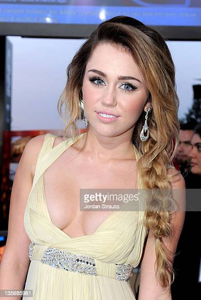 Actress/singer Miley Cyrus arrives at 2011 CNN Heroes An AllStar Tribute at The Shrine Auditorium on December 11 2011 in Los Angeles California...