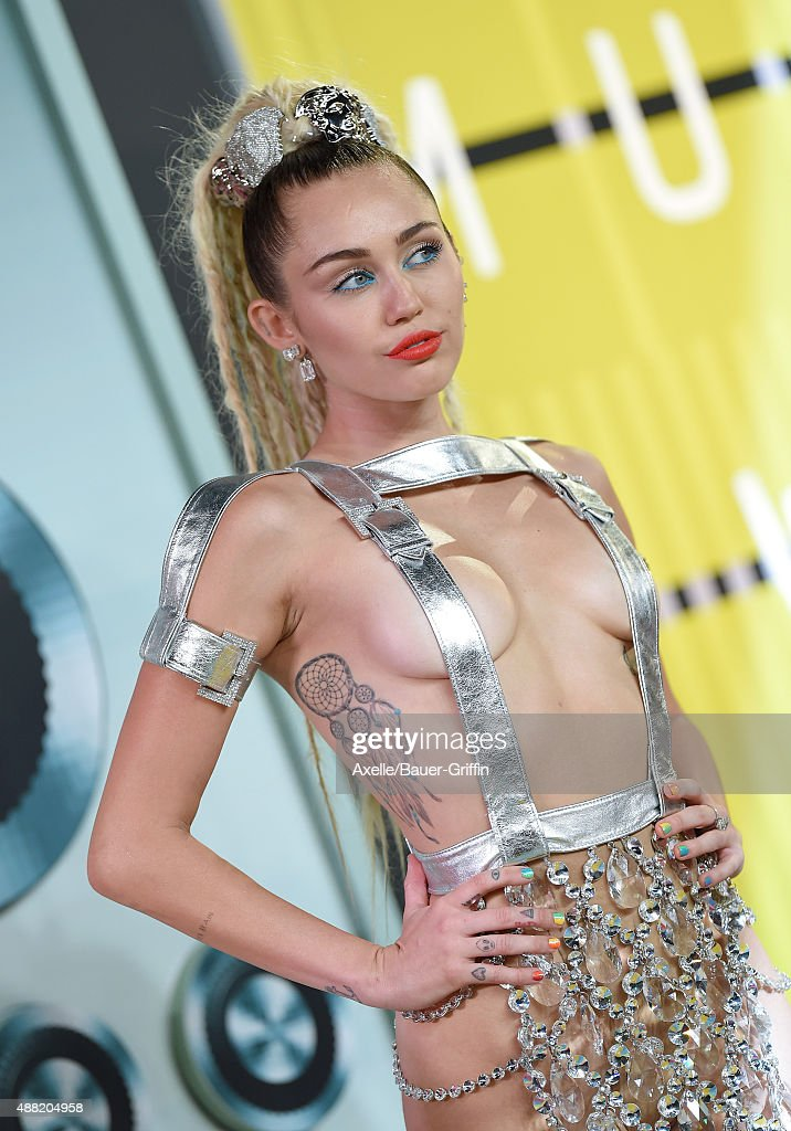 Actress/singer Miley Cyrus arrives at the 2015 MTV Video Music Awards at Microsoft Theater on August 30, 2015 in Los Angeles, California.