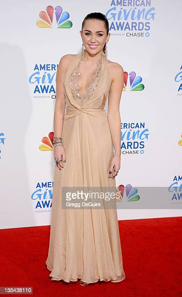 Actress/singer Miley Cyrus arrives at the American Giving Awards at Dorothy Chandler Pavilion on December 9 2011 in Los Angeles California