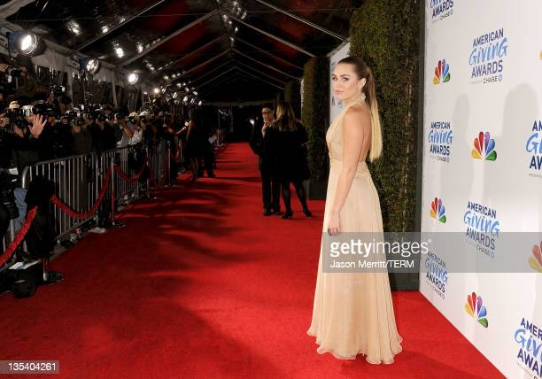 Actress/singer Miley Cyrus arrives at the American Giving Awards presented by Chase held at the Dorothy Chandler Pavilion on December 9, 2011 in Los...