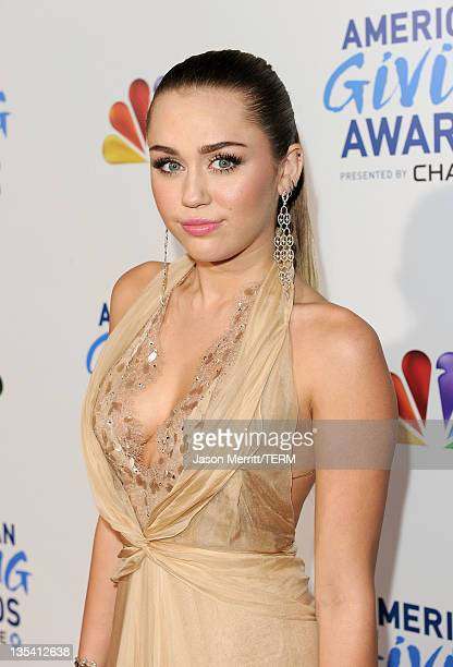 Actress/singer Miley Cyrus arrives at the American Giving Awards presented by Chase held at the Dorothy Chandler Pavilion on December 9 2011 in Los...