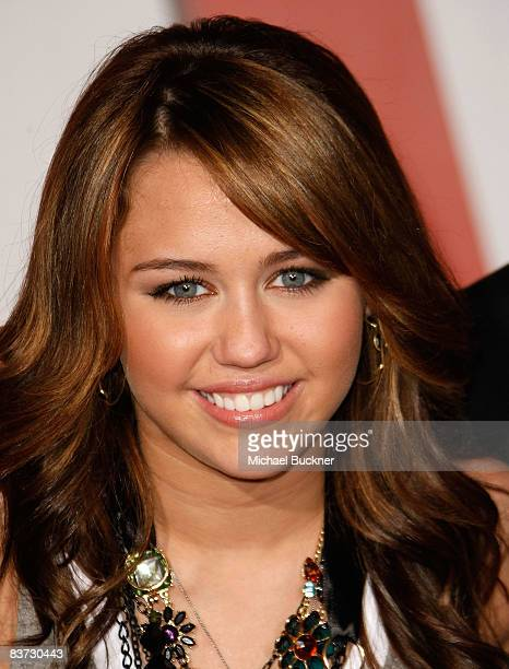 Actress/Singer Miley Cyrus arrives at the premiere of Walt Disney Animation Studios' Bolt held at the El Capitan Theatre on November 17 2008 in...