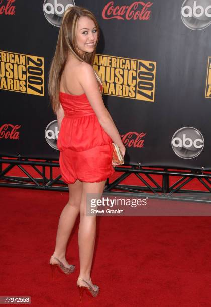 Actress/Singer Miley Cyrus arrives to the 2007 American Music Awards at the Nokia Theatre on November 18 2007 in Los Angeles California