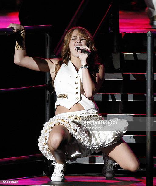 """Actress/singer Miley Cyrus performs at her """"Sweet 16"""" birthday celebration benefiting Youth Service America at Disneyland on October 5, 2008 in..."""