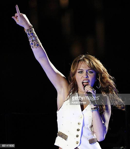 Actress/singer Miley Cyrus performs at her 'Sweet 16' birthday celebration benefiting Youth Service America at Disneyland on October 5 2008 in...