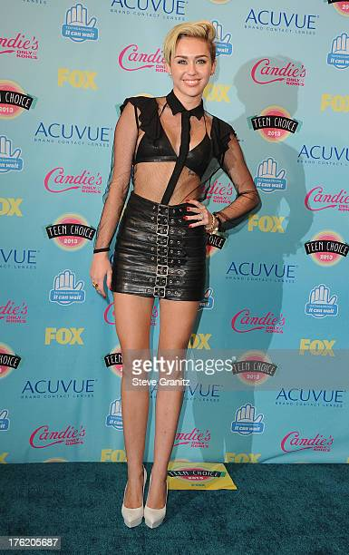 Actress/singer Miley Cyrus poses in the press room at the 2013 Teen Choice Awards at Gibson Amphitheatre on August 11 2013 in Universal City...