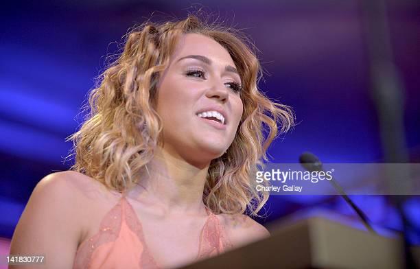 Actress/singer Miley Cyrus speaks onstage during Muhammad Ali's Celebrity Fight Night XVIII held at JW Marriott Desert Ridge Resort Spa on March 24...