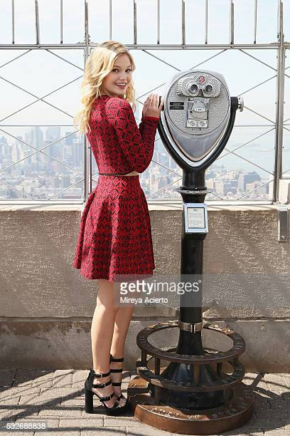 Actress/singer Olivia Holt visits the Empire State Building to promote her new single 'Phoenix' on May 19 2016 in New York New York