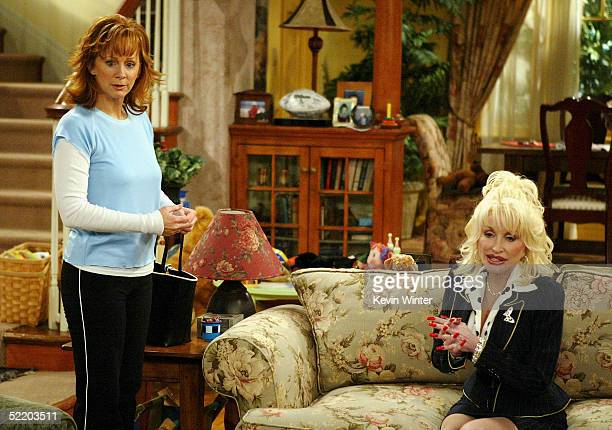 Actress/singer Reba McEntire and singer Dolly Parton appear on the set of The WB's Reba at 20th Century Fox Studios on February 15 2005 in Los...