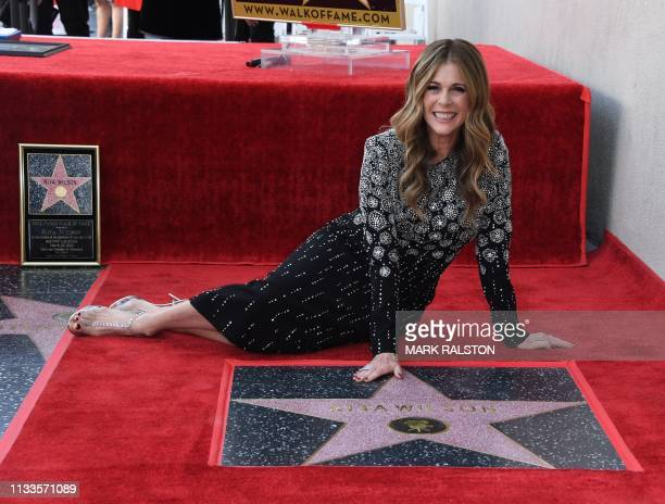 Actress/singer Rita Wilson poses with her newly unveiled star on the Hollywood Walk of Fame in Hollywood,, California on March 29, 2019.
