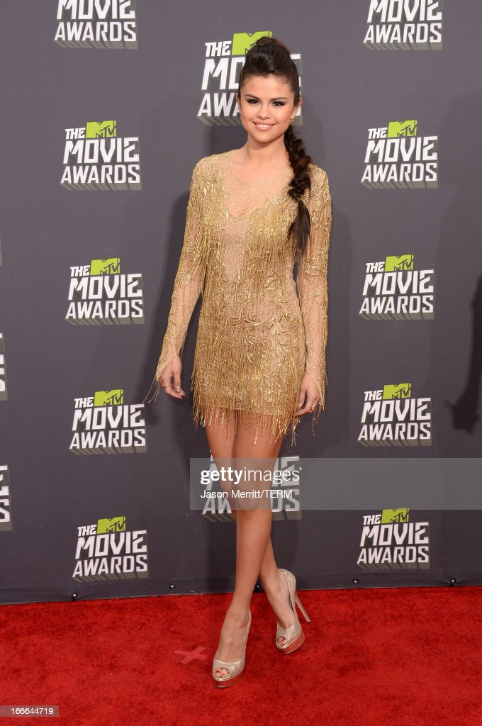 Actress-singer Selena Gomez arrives at the 2013 MTV Movie Awards at Sony Pictures Studios on April 14, 2013 in Culver City, California.